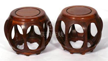 A pair of Chinese hardwood drum stools, 37cms (14.5ins) diameter.