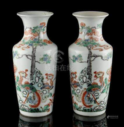 A pair of Chinese famille verte rouleau vases, late 19th / early 20th century, each painted with two