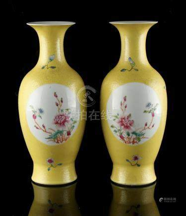 A pair of Chinese famille rose yellow sgraffito ground vases, with oval panels of butterflies &