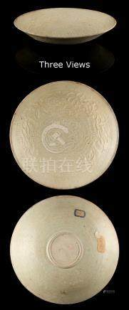 A good Chinese celadon glazed double phoenix dish, Song Dynasty (907-1279), moulded with two phoenix