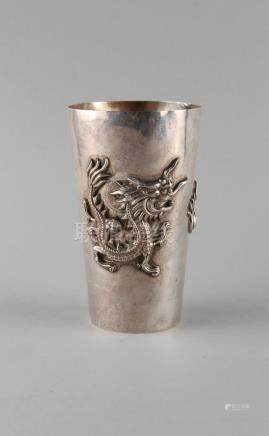 A late 19th / early 20th century Chinese silver beaker decorated in relief with two opposing dragons