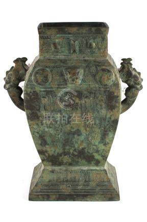 A Chinese archaistic bronze two-handled vase, of rectangular baluster form, 14.4ins. (36.5cms.) high