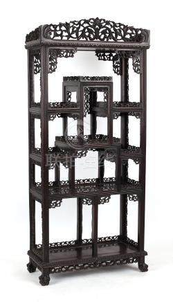 A good Chinese carved hongmu display cabinet, late 19th / early 20th century, with open shelves,