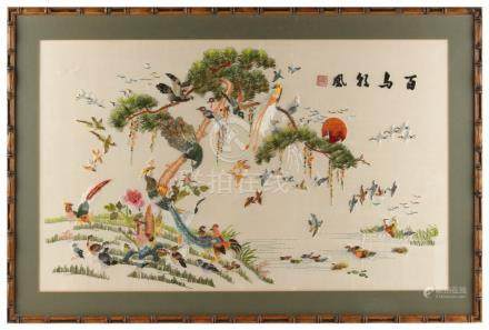 A Chinese embroidered silk panel depicting various birds around a pine tree by a pond, Republic