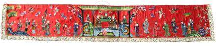 A Chinese embroidered red silk long panel depicting a court scene, late 19th / early 20th century,