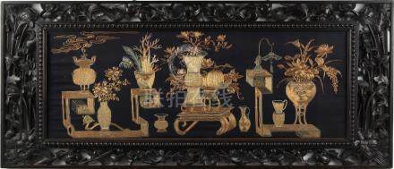 An early 20th century Chinese black silk panel embroidered in gilt thread with vases of flowers,