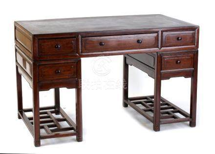 An early 20th century Chinese hongmu twin pedestal desk, 48ins. (122cms.) wide (see illustration).