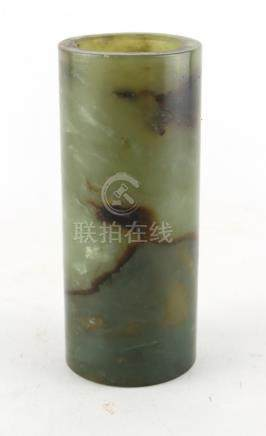 Property of a lady - a Chinese plain spinach jade brush pot, bitong, of slender cylindrical form.
