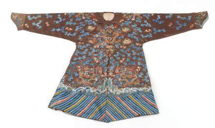 A good late 19th century Chinese embroidered chestnut brown silk robe with eight dragons above a