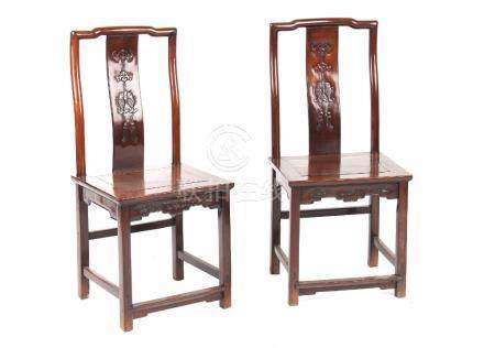 A pair of Chinese hongmu side chairs, late 19th century, the backs carved with a bat above twin fish