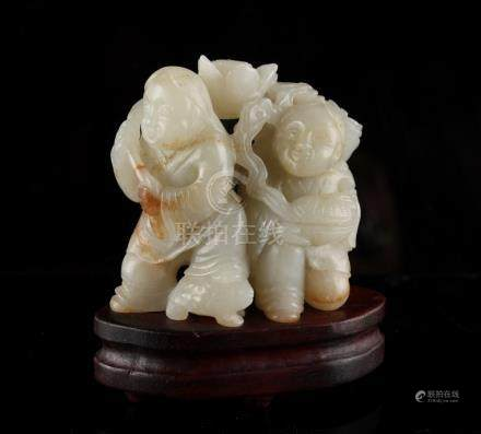 A Chinese carved pale jade group of Liu Hai with attendant, probably late 19th / early 20th century,
