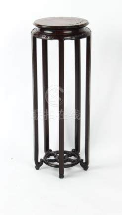 A good Chinese hongmu & burr wood tall stand, late 19th / early 20th century, the frieze carved in