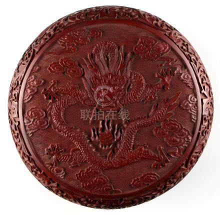 A Chinese carved cinnabar lacquer circular box & cover, decorated with a five clawed dragon