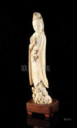 A 19th century Chinese carved ivory figure of Guanyin, modelled standing on a dragon & holding a