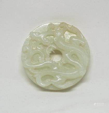 A Chinese White Jade Bi Disc