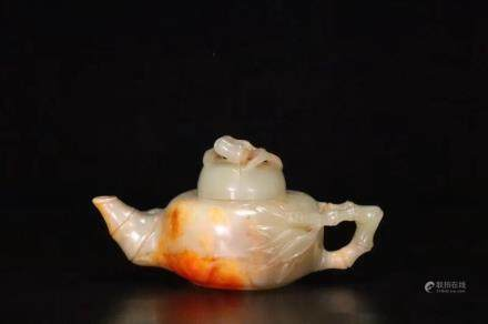A Carved Hetian Jade Teapot