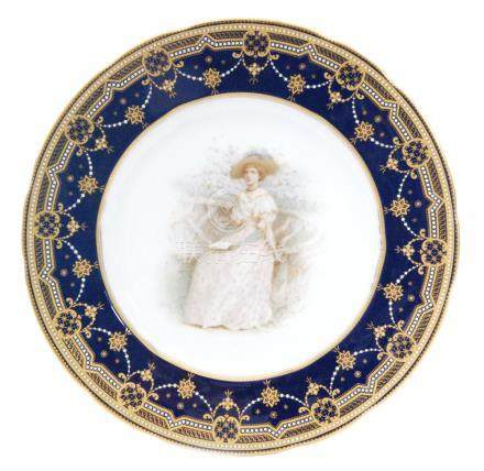 A Copelands China cabinet plate decorated with a hand painted Edwardian lady sat in a garden,