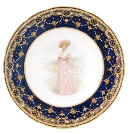 A Copelands China cabinet plate decorated with a hand painted Edwardian lady standing in a