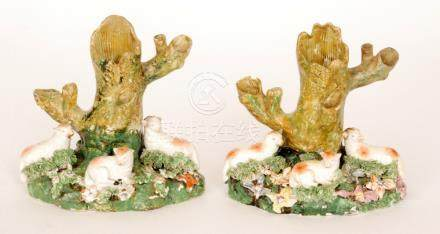 A pair of 19th Century Staffordshire spill vases each modelled with three resting sheep sat before