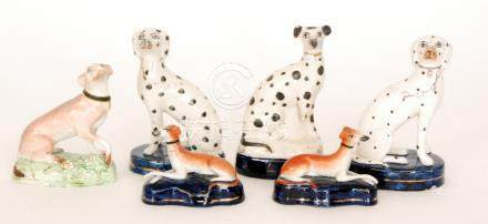Six assorted 19th Century Staffordshire model dogs,