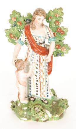 A 19th Century Staffordshire figure modelled as a lady in patterned dress and red robe stood before