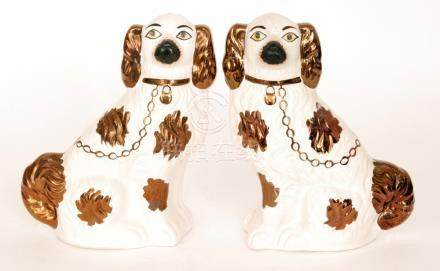 A pair of Victorian Staffordshire mantel spaniels with bronze lustre painted decoration,
