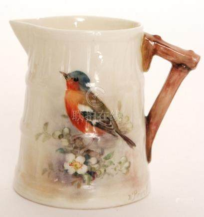 A small Royal Worcester cream jug of barrel form decorated by W Powell with a hand painted