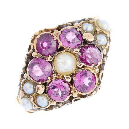 A mid Victorian gold garnet and split pearl cluster ring. The split pearl, with circular-shape