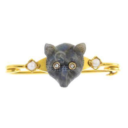 An early 20th century gem-set fox brooch. The carved labradorite fox head, with rose-cut diamond