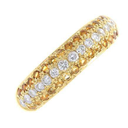 An 18ct gold diamond and citrine band ring. The brilliant-cut diamond line, with circular-shape