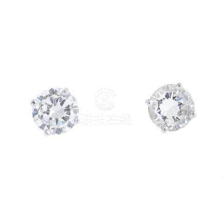 A pair of 18ct gold brilliant-cut diamond stud earrings. Estimated total diamond weight 0.60ct, I-