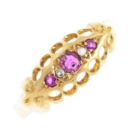 An early 20th century 18ct gold ruby, synthetic ruby and diamond ring. Designed as a circular-