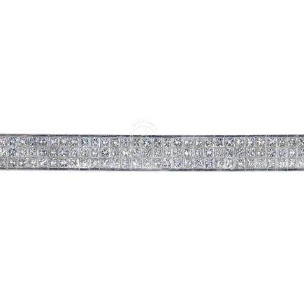 An 18ct gold diamond bracelet. The calibre-cut diamond panel, with concealed clasp. Estimated