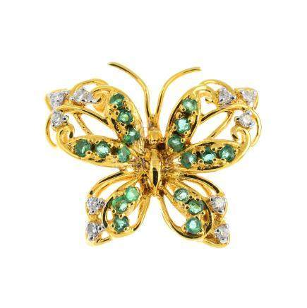 An 18ct gold emerald and diamond butterfly brooch. Of openwork design, with circular-shape emerald