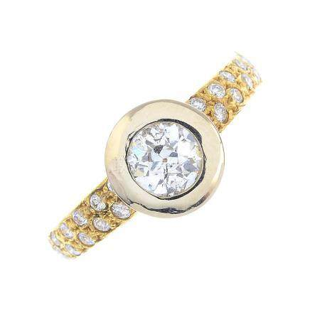 A diamond single-stone ring. The circular-cut diamond, within a collet setting, to the brilliant-cut