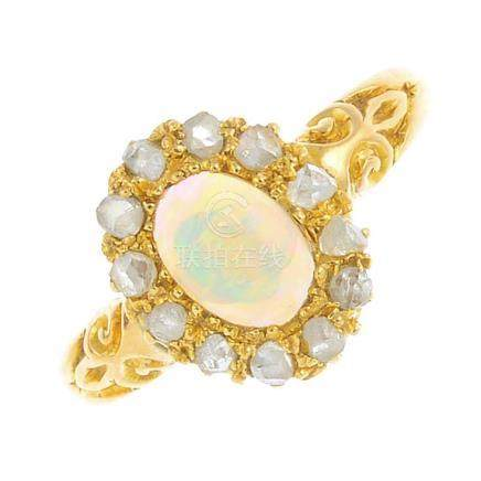 An 18ct gold opal and diamond dress ring. The oval opal cabochon, with rose-cut diamond surround.