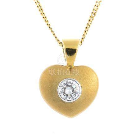 An 18ct gold diamond pendant. Designed as a heart-shape panel, with brilliant-cut diamond collet