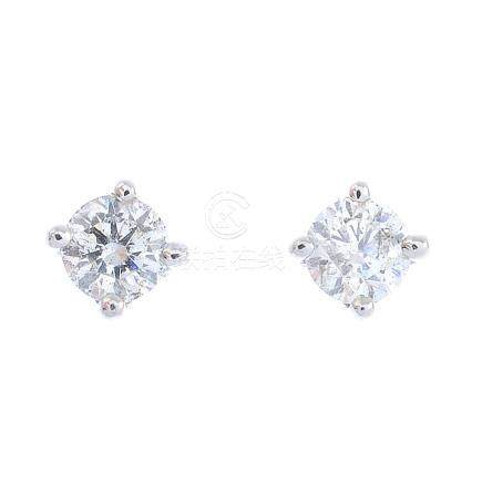 A pair of brilliant-cut diamond stud earrings. Estimated total diamond weight 0.40ct, H-I colour,