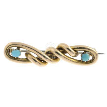 An early 20th century gold turquoise brooch. Designed as a looping interwoven bar, with circular