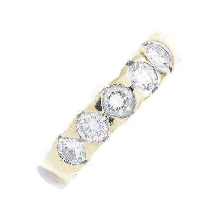 A diamond five-stone ring. The brilliant-cut diamond line, inset to the plain band. Estimated