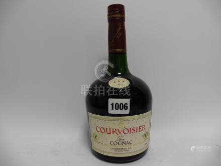 A bottle of Courvoisier 3 star Luxe Cognac 40% 1 litre duty free bottling circa 1980's/90's