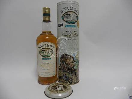 A bottle of Bowmore Legend Islay Single Malt Scotch Whisky limited Edition with tin and old style