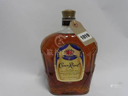 An old bottle of Crown Royal Fine De luxe Blended Canadian Whisky by Joseph E Seagram & Sons ltd