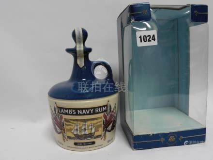 A Lamb's Navy Rum Ceramic Decanter depicting HMS Victory with box,