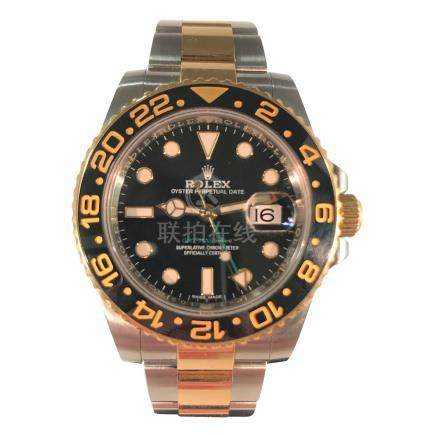 Rolex GMT Master II featuring Black and Gold Bezel