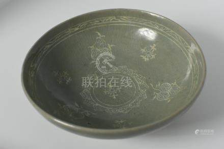 A celadon bowl with inlaid litchi design