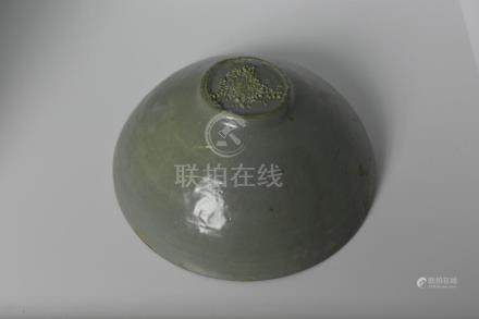 A celadon bowl with solar halo design