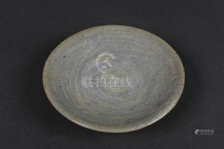 A buncheong bowl with brushed slip