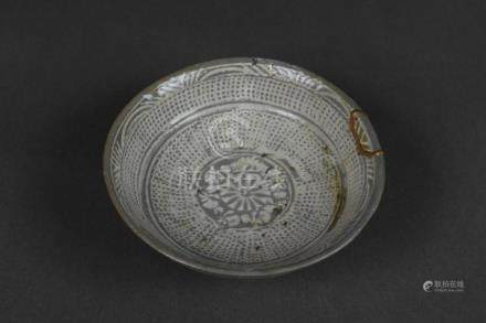 A buncheong bowl with stamped design