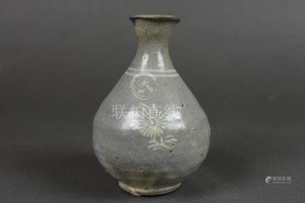 A buncheong bottle with inlaid chrysnathemum design